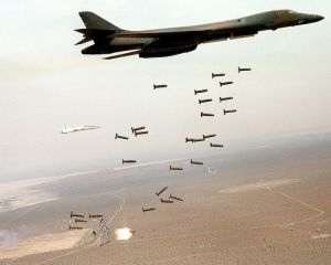 A US Air Force bomber drops cluster munitions during a training exercise.