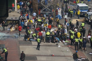 First responders tend to the wounded at the finish line for the Boston Marathon.